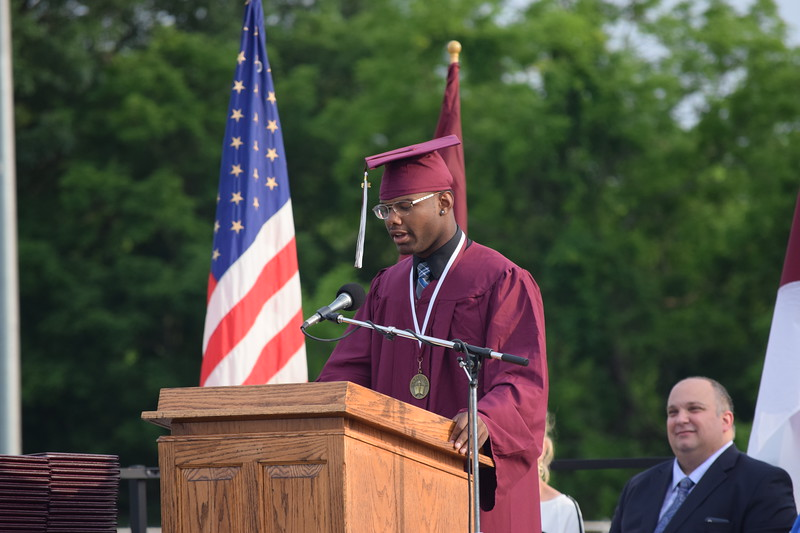 "Marian Dennis – Digital First Media<br /> Pottsgrove High School graduate Ashon Calhoun recites a poem entitled ""Young Soldier"" that he wrote specifically for graduation."
