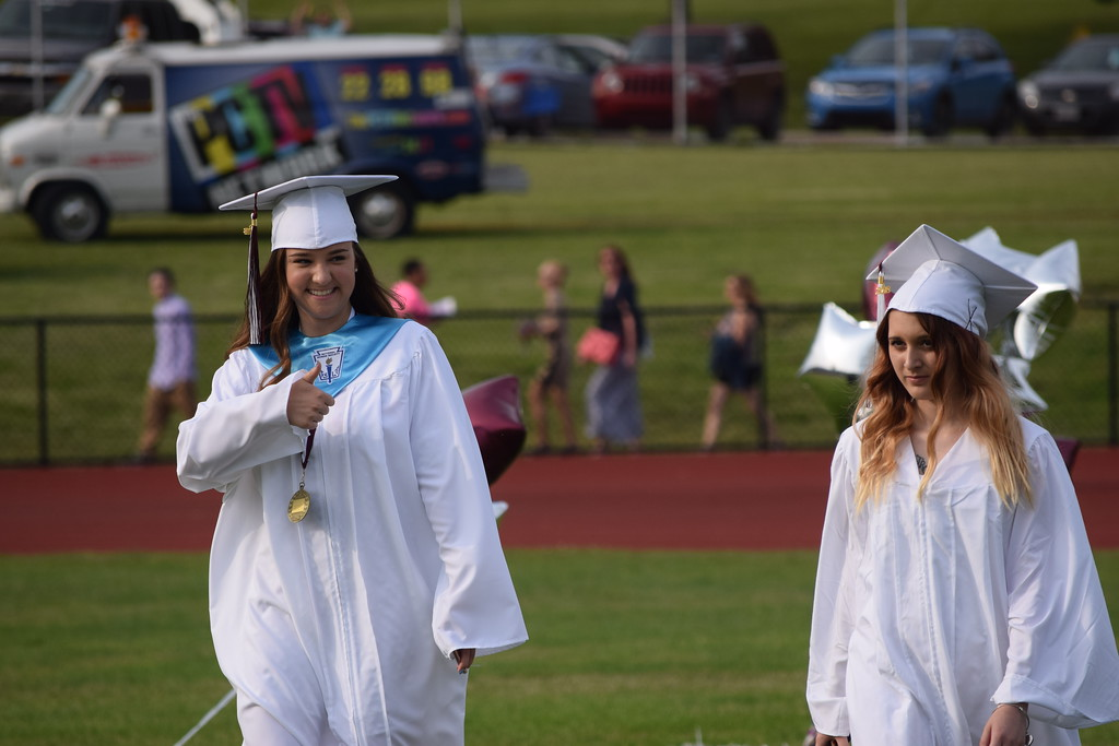 . Marian Dennis � Digital First Media Graduates gave a thumbs up as they made their entrance to the field Friday during the 62nd commencement exercises.