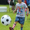 Isaiah Jeter, 10, kicks a ball into a goal during a celebration for families at the Pottstown High School on Saturday. The event include several healthy, fitness activities for children.