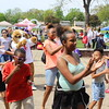 Children dance to music during a celebration for families at the Pottstown High School on Saturday. Hundreds of families were in attendance for the event.