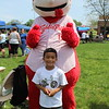 Jose Moctezuma, 6, poses with a mascot at Pottstown celebration for families at the high school on Saturday. The event was full of games, music and fun.