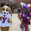 MoniYah Pearson-Henderson, 12, dances alongside the YMCA mascot during the combined Pottstown Celebrates Young Children event and the YMCA Healthy Kids Day at the high school on Saturday.