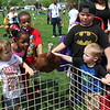 Children pet a turkey that was part of a petting farm at the combined Pottstown Celebrates Young Children event and the YMCA Health Kids Day at the high school on Saturday.