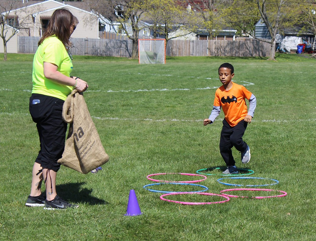 . Michilea Patterson, Digital First Media  Nine-year-old Caron Artis participates in an obstacle course during a celebration of children in Pottstown.