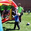 Michilea Patterson, Digital First Media <br /> A young boy shoots a basket in an inflatable game center during a celebration of children in Pottstown.
