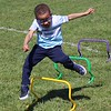 Michilea Patterson, Digital First Media <br /> Four-year-old Gavin Harris jumps over bars as part of a kids obstacle course during the combined PEAK Pottstown Celebrates Young Children event and the YMCA Healthy Kids Day.