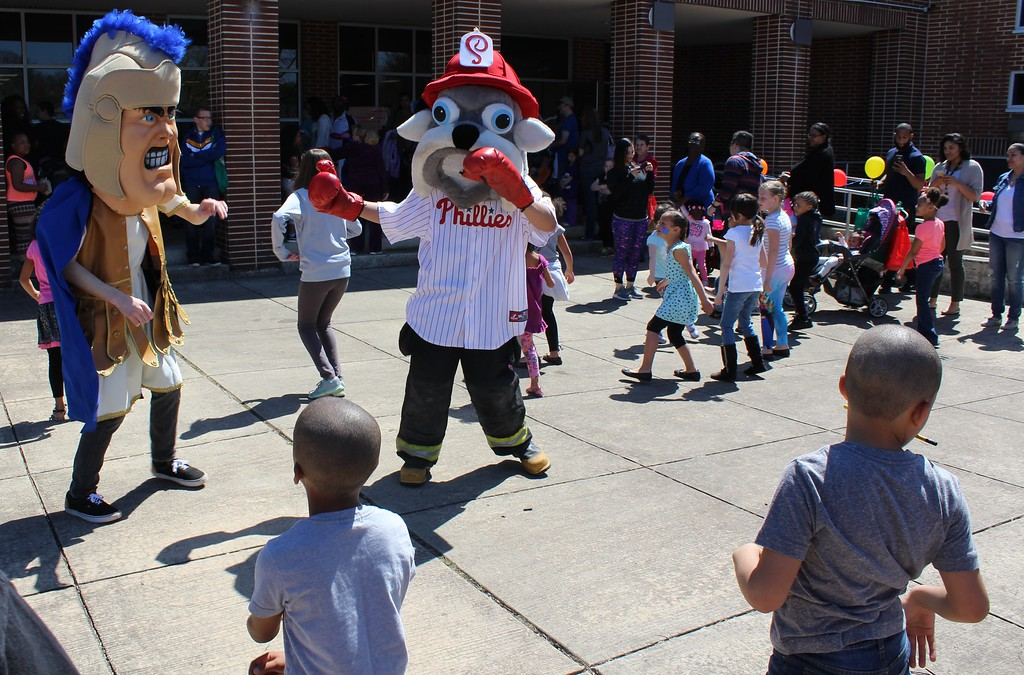 . Michilea Patterson, Digital First Media Mascots dance alongside children to music during the combined PEAK Pottstown Celebrates Young Children and YMCA Healthy Kids Day event Saturday afternoon.