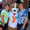 Michilea Patterson, Digital First Media<br /> A YMCA mascot stands between Pottstown YMCA Program Director Lynn Seponski, left, and Membership Director Sandy Creasy, right, during a celebration of children at Pottstown High School.