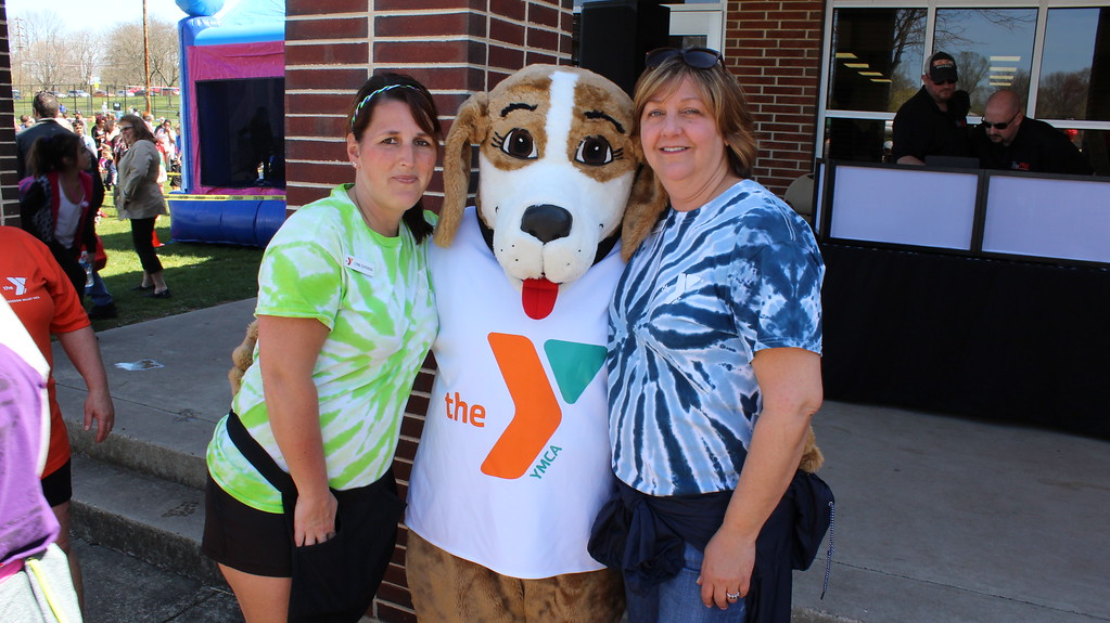 . Michilea Patterson, Digital First Media A YMCA mascot stands between Pottstown YMCA Program Director Lynn Seponski, left, and Membership Director Sandy Creasy, right, during a celebration of children at Pottstown High School.