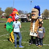 Michilea Patterson, Digital First Media <br /> A chicken mascot and Pottstown High School's Trojan Man walk around during a celebration of children in Pottstown.