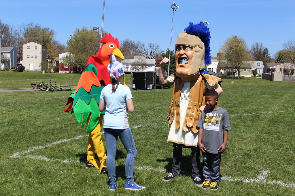 . Michilea Patterson, Digital First Media  A chicken mascot and Pottstown High School\'s Trojan Man walk around during a celebration of children in Pottstown.