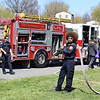 Michilea Patterson, Digital First Media <br /> A man stands with a long hose in front of a fire truck during the combined 2016 PEAK Pottstown Celebrates Young Children event and Pottstown YMCA Healthy Kids Day.