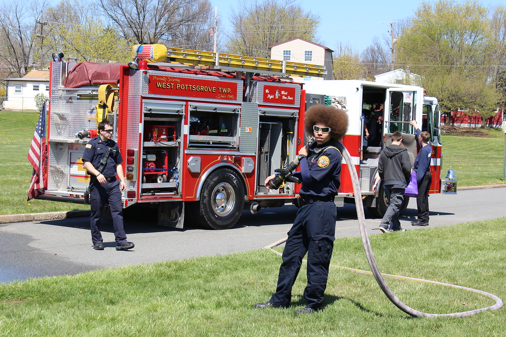 . Michilea Patterson, Digital First Media  A man stands with a long hose in front of a fire truck during the combined 2016 PEAK Pottstown Celebrates Young Children event and Pottstown YMCA Healthy Kids Day.