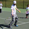Michilea Patterson, Digital First Media<br /> Greater Pottstown Tennis & Learning instructor Chris Herdelin teaches children some basics of the sport during the combined PEAK Pottstown Celebrates Young Children and YMCA Healthy Kids Day event Saturday.