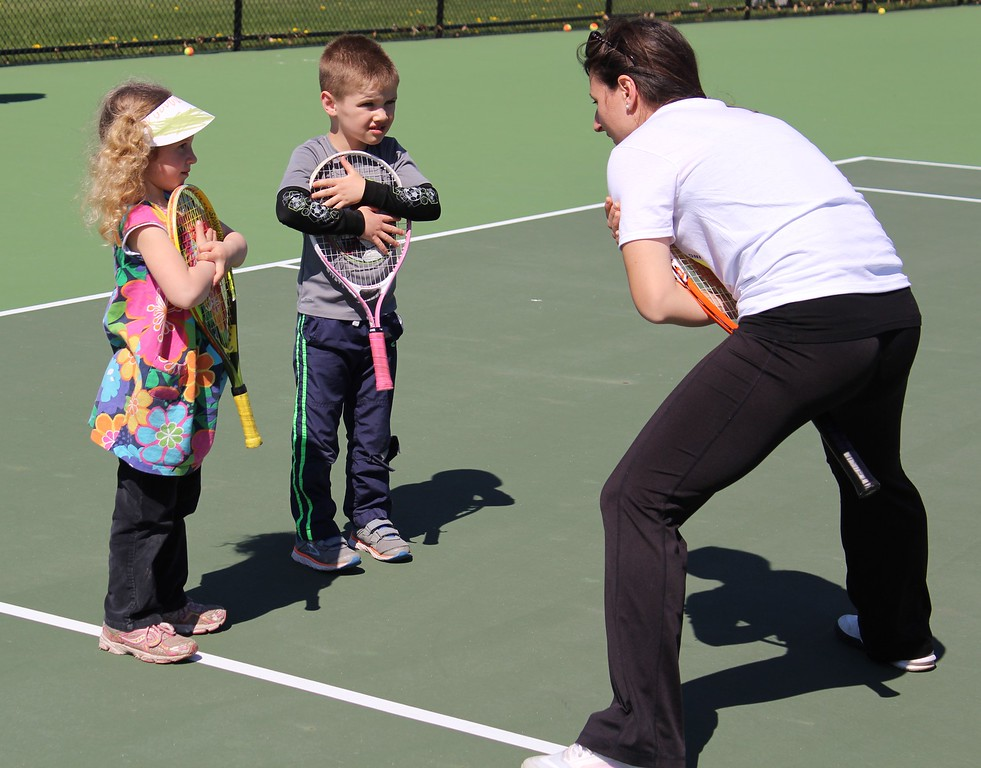 . Michilea Patterson, Digital First Media Danielle Bechtel, 4, and Alex Bechtel, 5, get some instruction from a representative of Greater Pottstown Tennis & Learning during the combined PEAK Celebrates Young Children and YMCA Healthy Kids Day event Saturday.