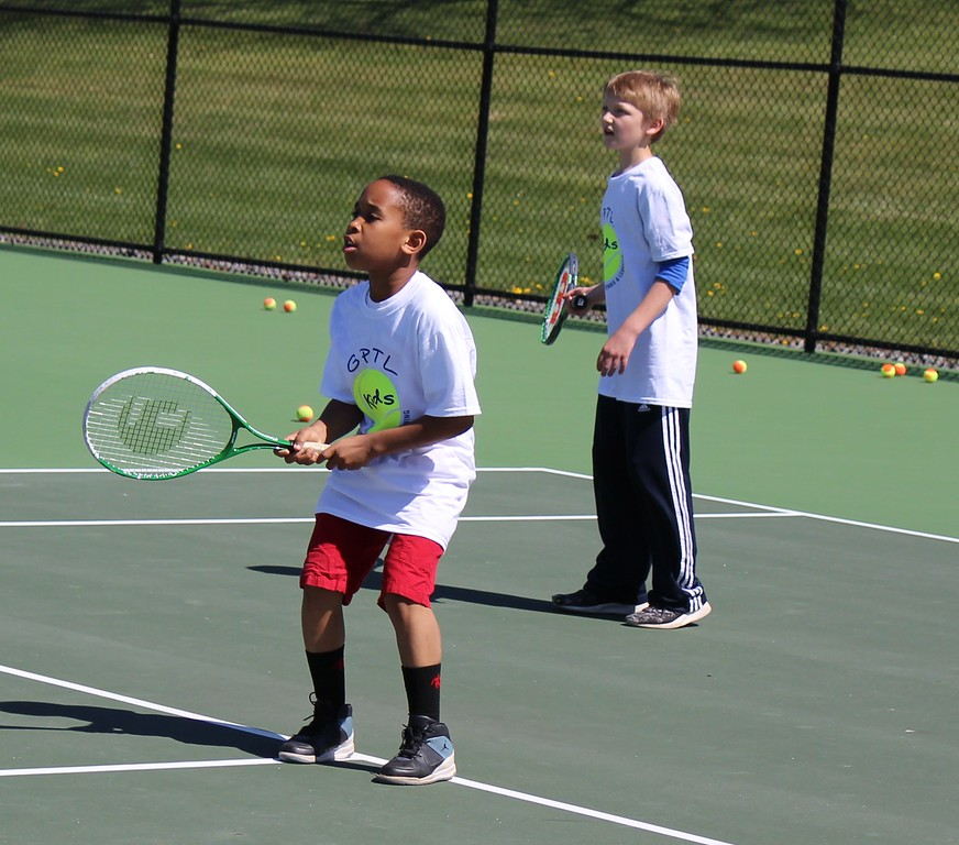 . Michilea Patterson, Digital First Media  Children participate in a tennis game as part of a free clinic during a celebration for children in Pottstown.