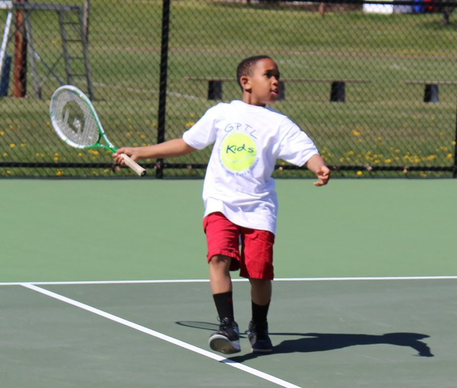 . Michilea Patterson, Digital First Media  A boy participates in a game of tennis during a celebration of children at Pottstown High School.