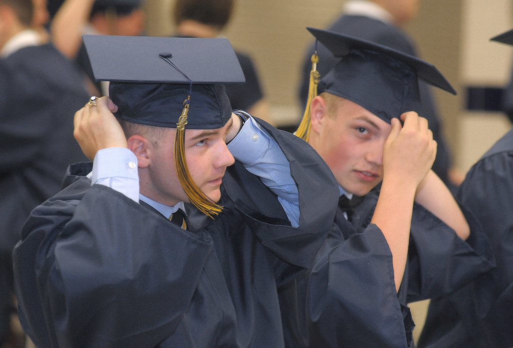 . Gene Walsh � Digital First Media Braendon Sheldon and Benjamin Leister adjust toecap as they prepare for the start of graduation ceremonies June 13, 2018.