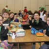 """East Vincent Elementary students raise healthy and green spinach smoothies during lunch on Friday, March 17, 2017. The school had a """"power up with spinach"""" celebration for St. Patrick's Day."""