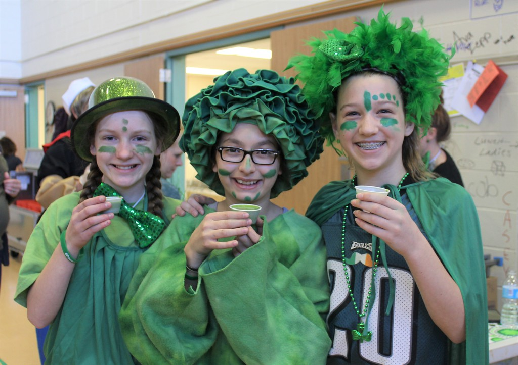 . From left to right, 6th graders Marie Tokay, Adelyse D\'Arcy and Paige Lobb wear green costumes for St. Patrick\'s Day while they drink healthy, green smoothies at East Vincent Elementary School.
