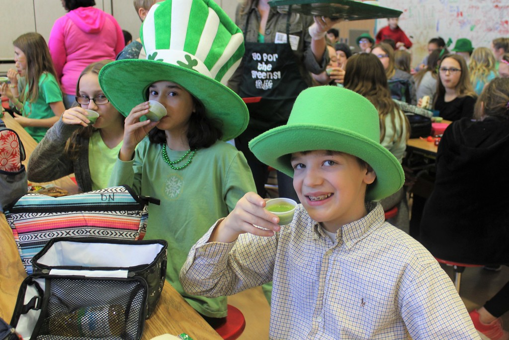 . East Vincent Elementary School students drink healthy and green spinach smoothies during lunch on St. Patrick\'s Day.