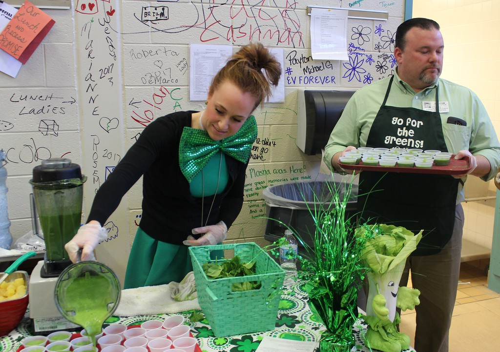 . Heather Bonner, of Chartwells Food Service, pours a healthy spinach smoothie she prepared for students in honor of St. Patrick\'s Day on Friday, March 17, 2017.