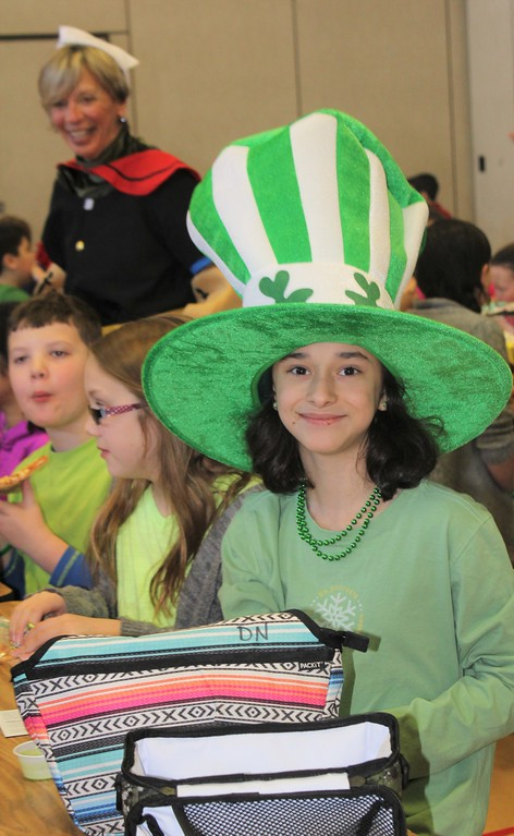 . Danielle Nemeth, 10, wears green and a huge hat in honor of St. Patrick\'s Day at East Vincent Elementary School.