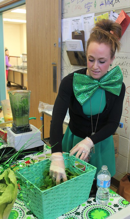 . Heather Bonner, of Chartwells Food Service, makes healthy and green spinach smoothies for students at East Vincent Elementary School on St. Patrick\'s Day.