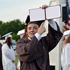 Kevin Debus showed his family that he earned a diploma at Perkiomen Valley High School's graduation Friday night. Debby High - For Digital First Media