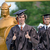 Thomas Armstrong marches into the Perkiomen Valley High School graduation ceremony Friday with his thumbs up. Debby High - For Digital First Media