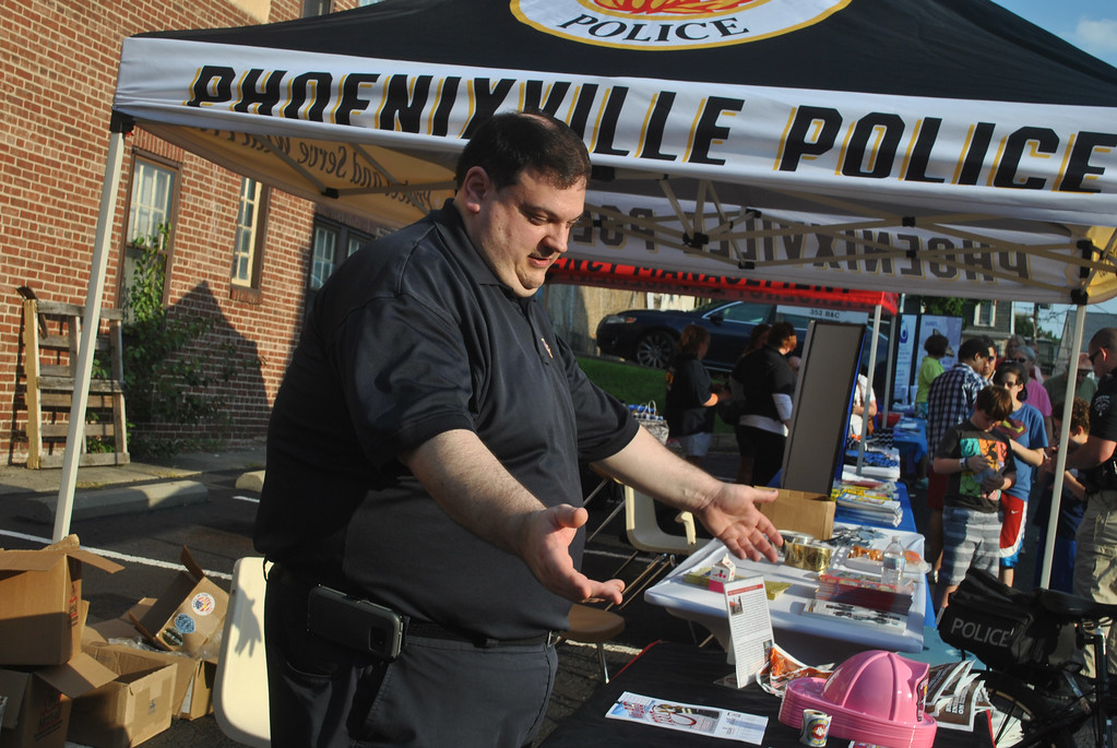 . Phoenixville Fire Department�s Chris Brignola shows off a lot of the cool stuff from the fire department for the kids at National Night Out. Photo by Barry Taglieber � For Digital First Media
