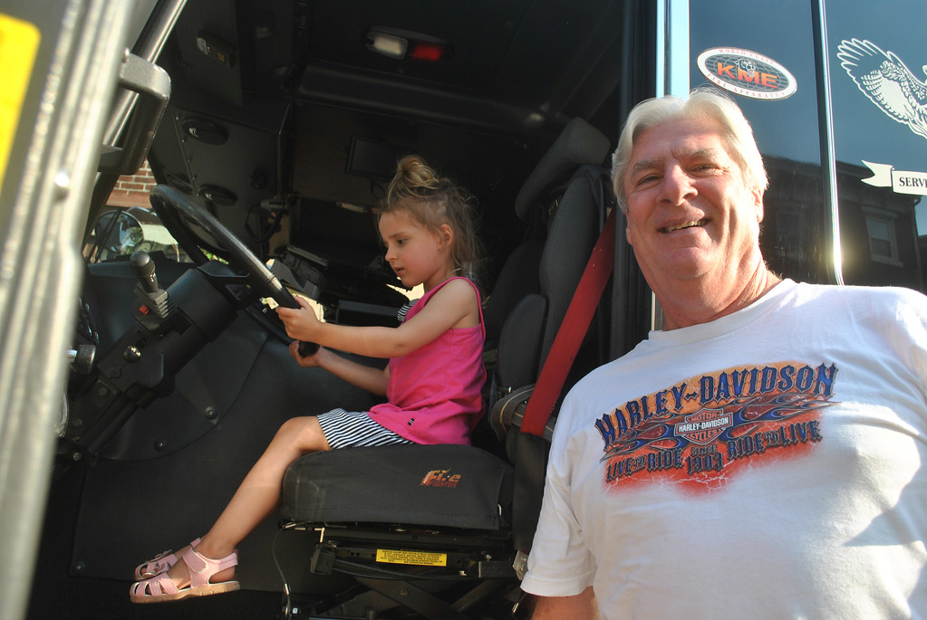 . Claire Cowan with her grandad Joe Cowan checks out one of the fire trucks on display at National Night Out in Phoenixville. Photo by Barry Taglieber � For Digital First Media