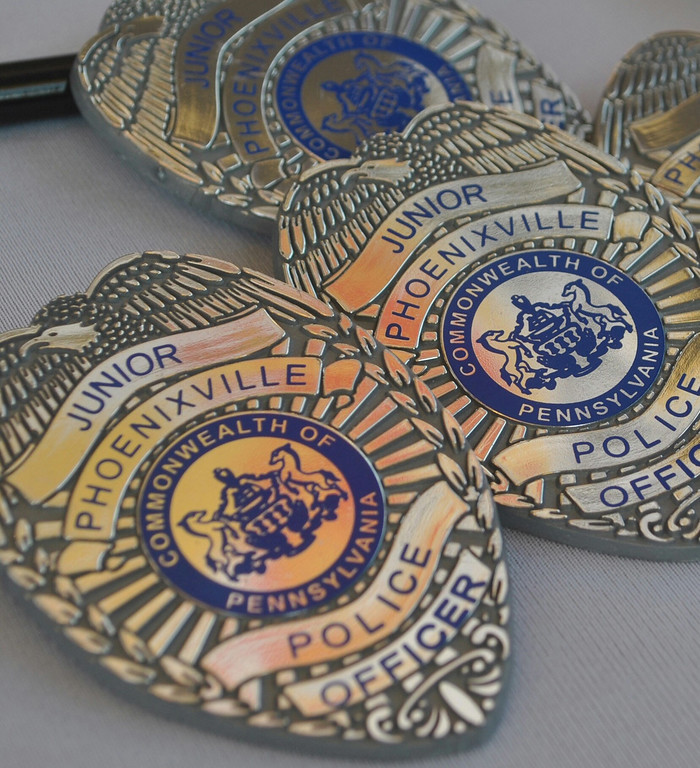 . The Phoenixville Police Department was handing out Junior Police Officer badges like these at National Night Out. Photo by Barry Taglieber � For Digital First Media