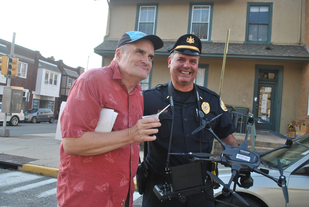 . Jack along with Phoenixville Police Sgt. Brian Marshall test out the department�s drone during National Night Out festivities.  Photo by Barry Taglieber � For Digital First Media