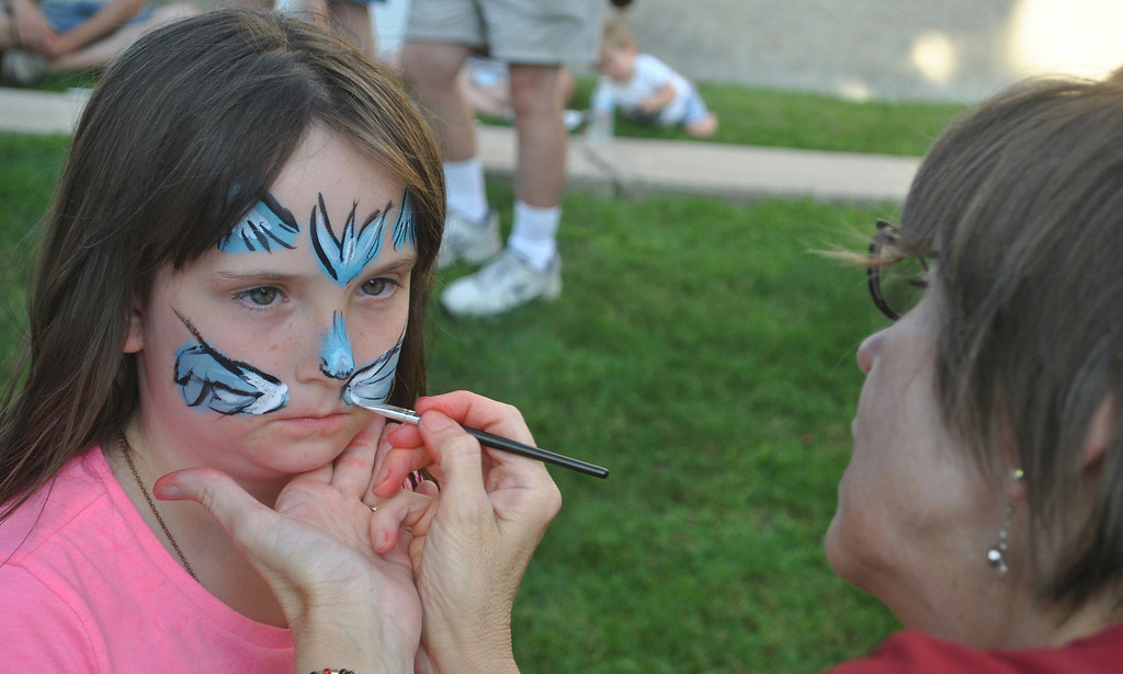 . Rachael Marple waits patiently as she gets her face painted during National Night Out festivities in Phoenixville. Photo by Barry Taglieber � For Digital First Media