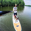 Trevor DeHaas paddle boards with Kahlua, his dog and travel companion, on one of his many adventures across the U.S. Photo Courtesy of Trevor DeHaas