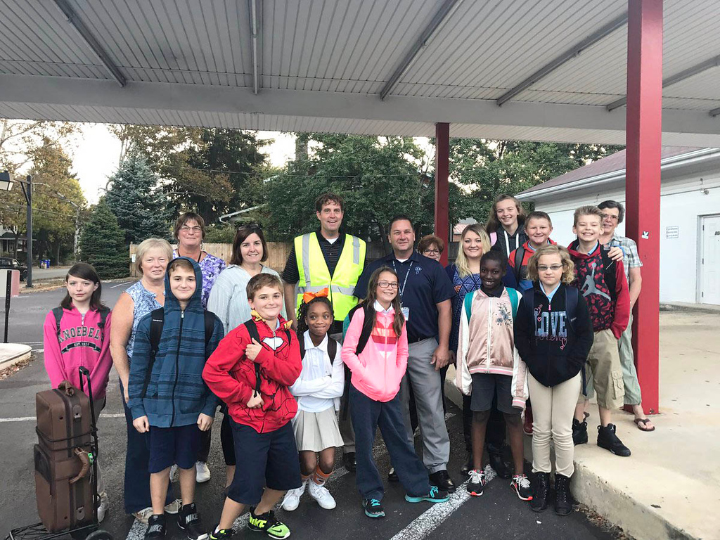 . Pottstown Middle School students pause at the corner of Wilson and North Charlotte streets, on their way to school for National Walk to School Day.