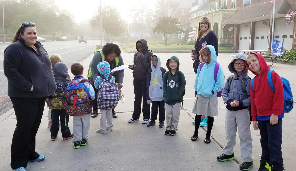 . Students on Rupert Elementary School\'s Walking School Bus pause in front of the Goodwill Fire Company on High Street.