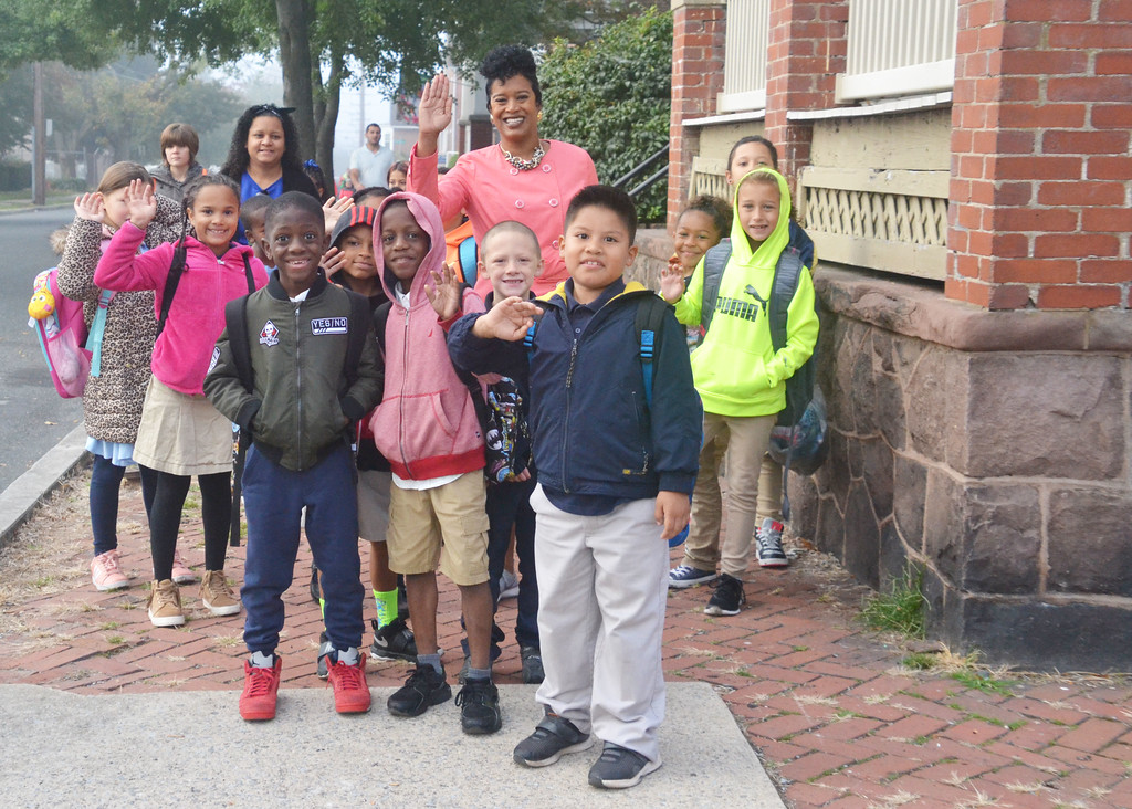 . Lincoln Elementary School Principal Calista Boyer welcomes students to school Wednesday, National Walk to School Day.