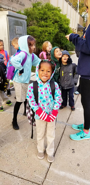 . Gloves secured, Rupert\'s Walking School Bus proceeds down High Street past the Pottstown Post Office on their way to school.