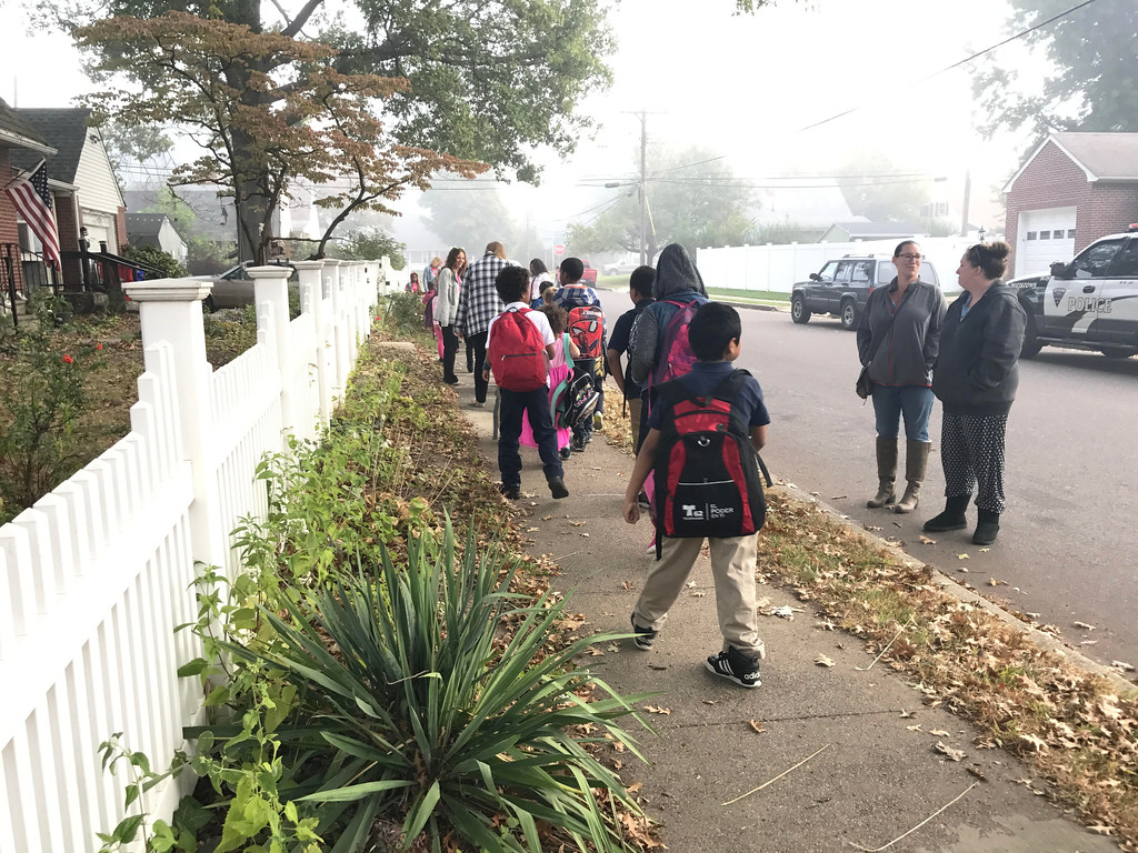 . Wednesday morning was a bit foggy as students, accompanied by parents, teachers and volunteers, make their way to Barth Elementary School for National Walk to School Day.