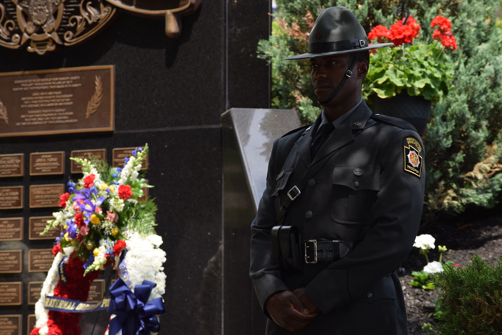 . Marian Dennis � Digital First Media State troopers and local police stood around the Fraternal Order of Police memorial that sits at the front of the Montgomery County Courthouse in Norristown. A ceremony was held Friday to honor the fallen officers who died or were killed in the line of duty.