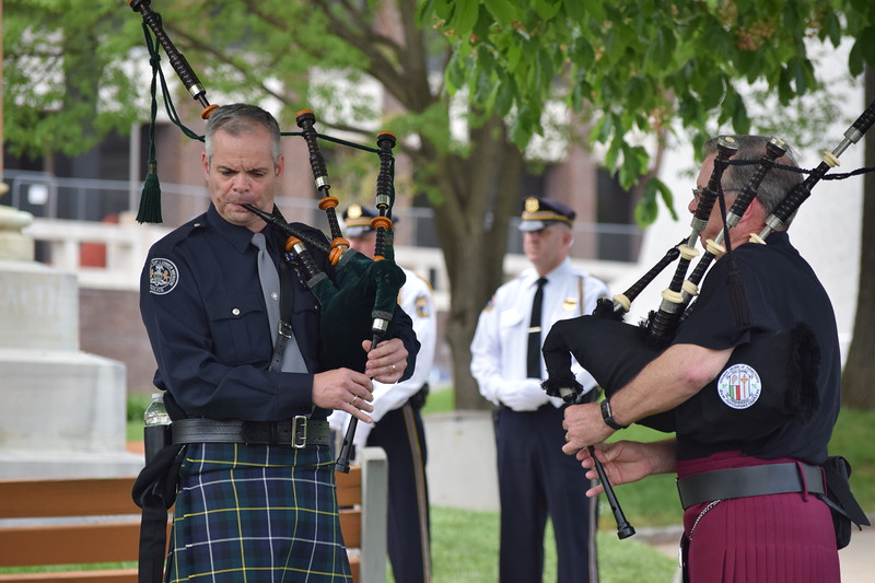 "Marian Dennis – Digital First Media<br /> Toward the conclusion of the ceremony Friday honoring fallen Montgomery County officers, ""Amazing Grace"" was played on the bagpipes after 28 names were read aloud."