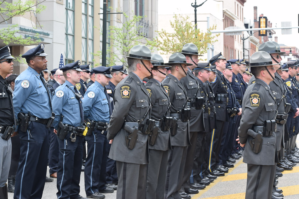 . Marian Dennis � Digital First Media Montgomery County police officers and Pennsylvania State Troopers lined Main Street in Norristown Friday during the Montgomery County Police Officer Memorial.