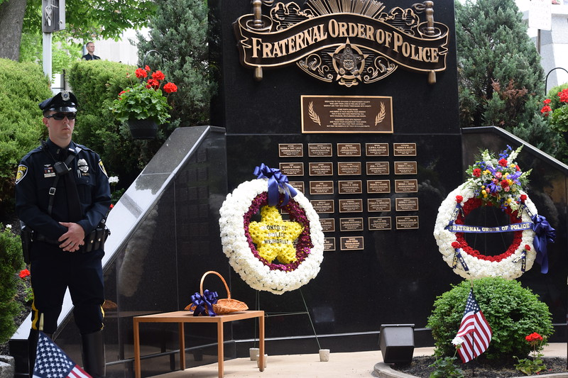 Marian Dennis – Digital First Media<br /> Wreaths and a basket of flowers adorned the Fraternal Order of Police Memorial that sits outside the Montgomery County Courthouse. A memorial service was held Friday to honor fallen Montgomery County officers.