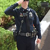 Marian Dennis – Digital First Media<br /> Officers stood at attention and saluted during the raising of the flags, beginning the Montgomery County Police Memorial in Norristown on Friday.
