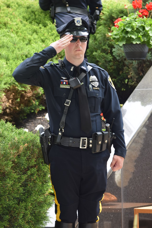 . Marian Dennis � Digital First Media Officers stood at attention and saluted during the raising of the flags, beginning the Montgomery County Police Memorial in Norristown on Friday.