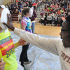 John Strickler - Digital First Media<br /> Tyrell Barr pushes a plate filled with pie onto the face of Jaime Reinhart during the Pottsgrove High School pep rally as the school gets ready for their mini-thon in May.