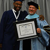 Jeff Davis -- Digital First Media Pottstown School Board member and 2016 graduation Emanuel Wilkerson presents Superintendent Jeff Sparagana, who retires this year, with an honorary Pottstown High School diploma.