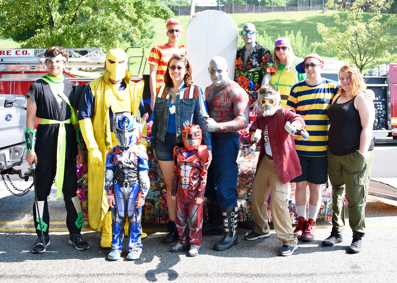 Jesi Yost — For Digital First Media<br /> Staff, family and friends from Krav'n Comics in Upland Square dress up as their favorite comic book characters to participate in the Pottstown Fourth of July Parade.